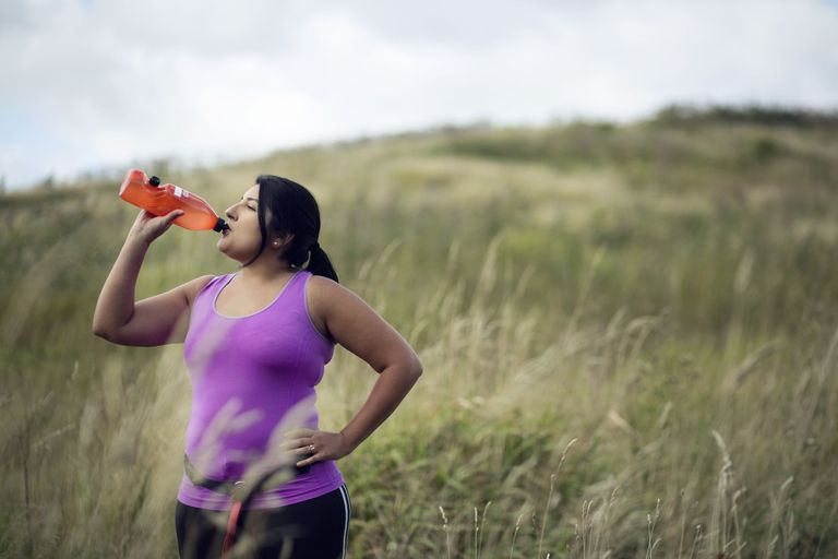 female-jogger-drinking-water-gettyimages-627573713-574605f45f9b58723d32980d